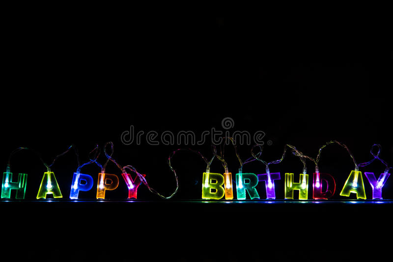 Happy birthday glowing letters background. Happy birthday glowing letters lamps background royalty free stock photography