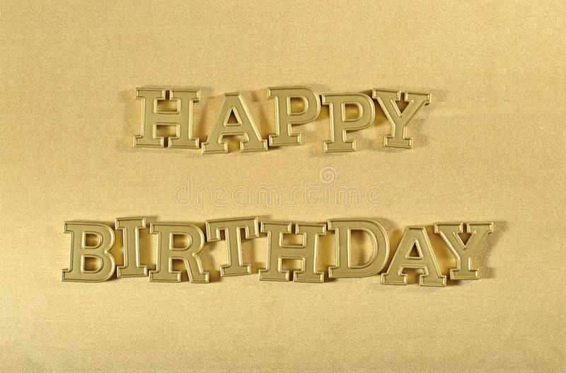 Happy birthday golden text on a golden. Background stock image
