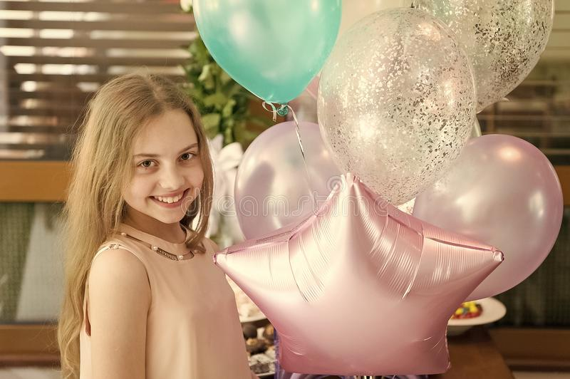 Happy birthday, gorgeous. Happy little girl celebrating birthday with party balloons. Adorable small child enjoying. Congratulation on her birthday. Birthday stock photography
