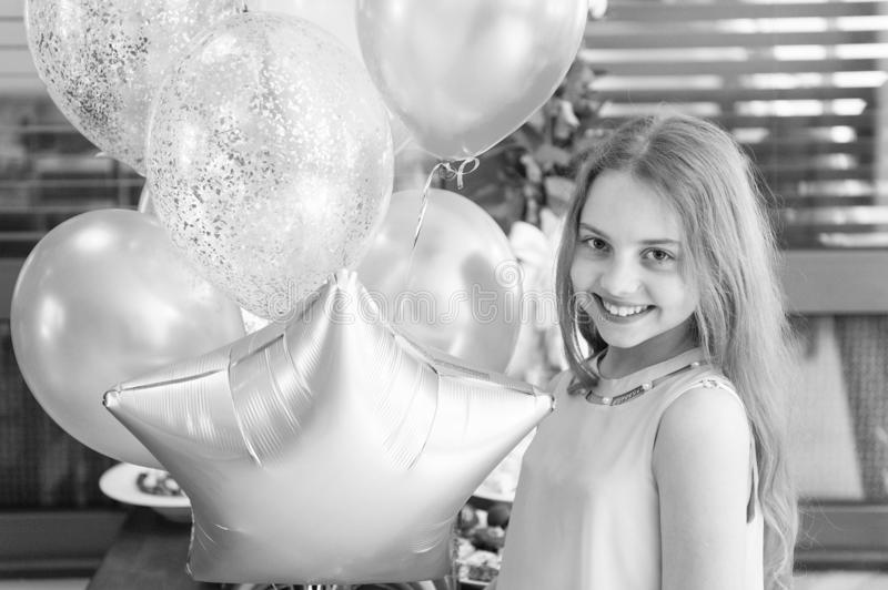 Happy birthday, gorgeous. Happy little girl celebrating birthday with party balloons. Adorable small child enjoying royalty free stock photography