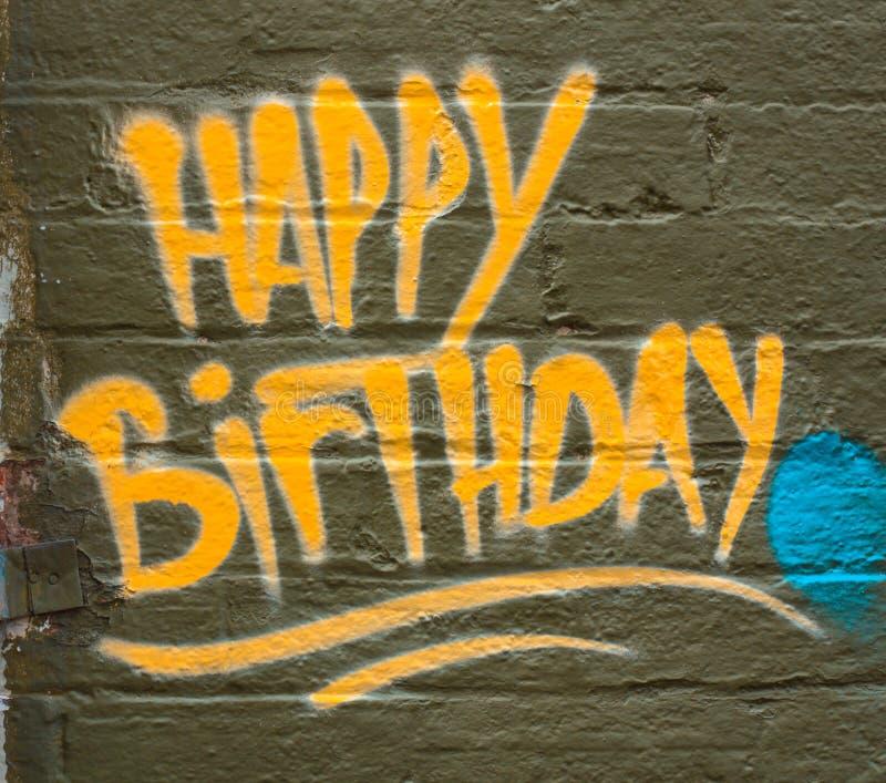 Happy birthday graffiti greeting. Happy Birthday graffiti greeting on a brick wall stock images