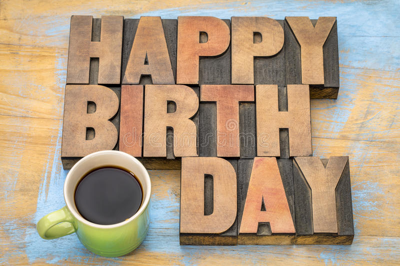 Happy Birthday greeting card. Happy Birthday word abstract - a greeting card in vintage letterpress wood type blocks with a cup of coffee royalty free stock photos