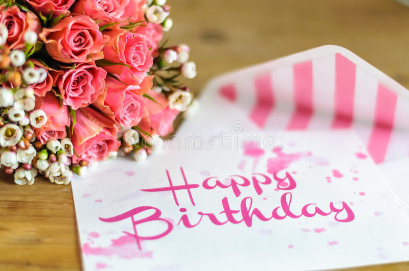 Happy birthday greetings. Happy birthday greeting card with color fitting bouquet of flowers stock photo