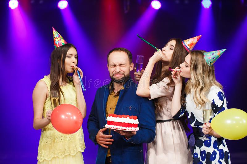 Happy birthday. Group of smiling friends gathered together with cake. royalty free stock photo