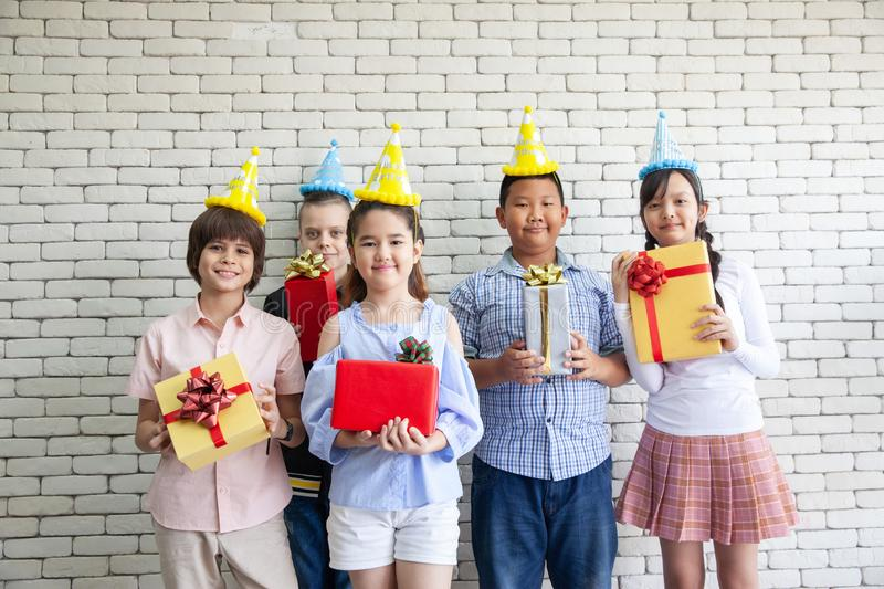 Happy Birthday. Group young people celebrates the holiday with a gifts. Congratulations to a friend stock photo
