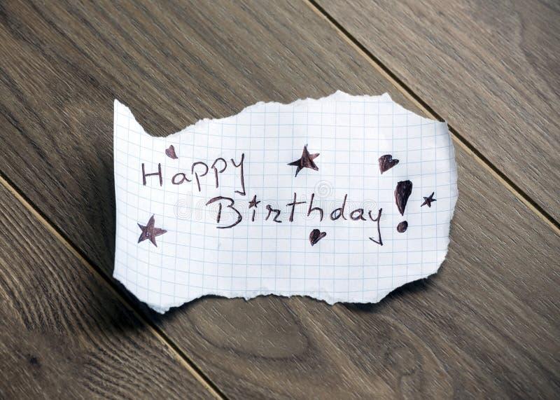Happy Birthday. Hand writing text on wood background stock photo