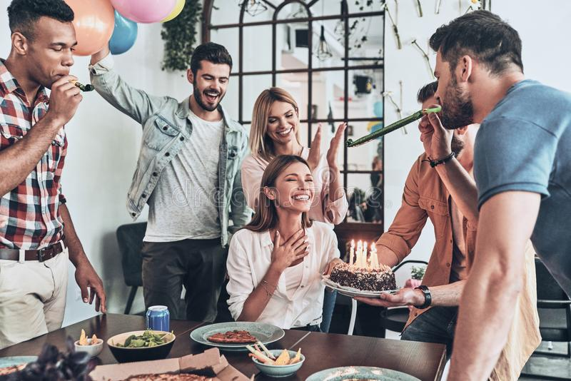 Happy birthday!. Group of happy people celebrating birthday among friends and smiling while having a dinner party royalty free stock image