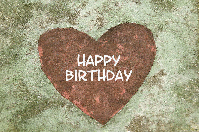 Happy Birthday Heart. A concrete slab with a red heart shape in the middle with the text, Happy Birthday royalty free stock photography