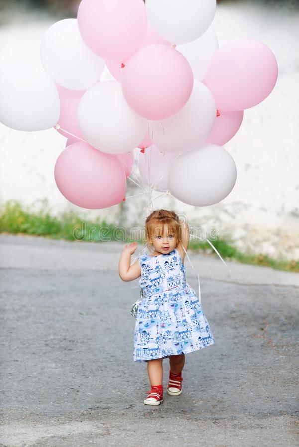 Happy birthday holiday. Of sweet little toddler girl stock photo