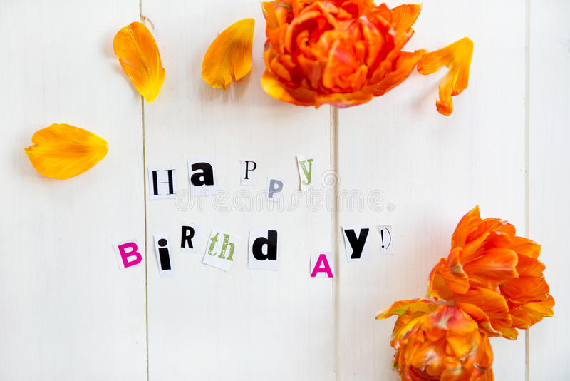 Happy Birthday Letters. Cut out from Magazine and Orange Tulip stock images