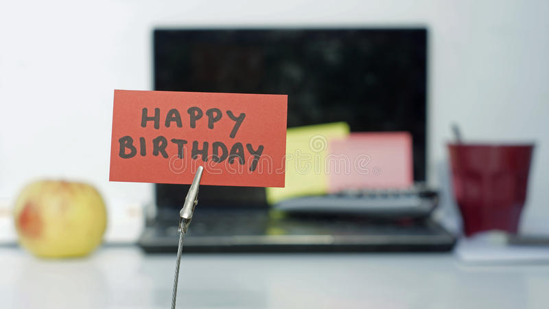 Happy birthday memo. Happy birthday written on a memo at the office stock photography