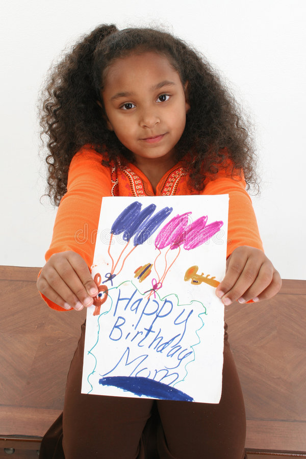 Happy Birthday Mom. Adorable five year old African American girl holding hand made birthday card stock photo