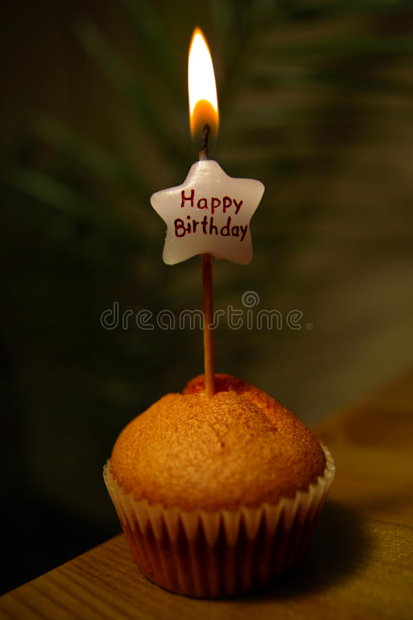 Happy Birthday muffin. Image shows muffin and candle with words 'Happy Birthday royalty free stock photo