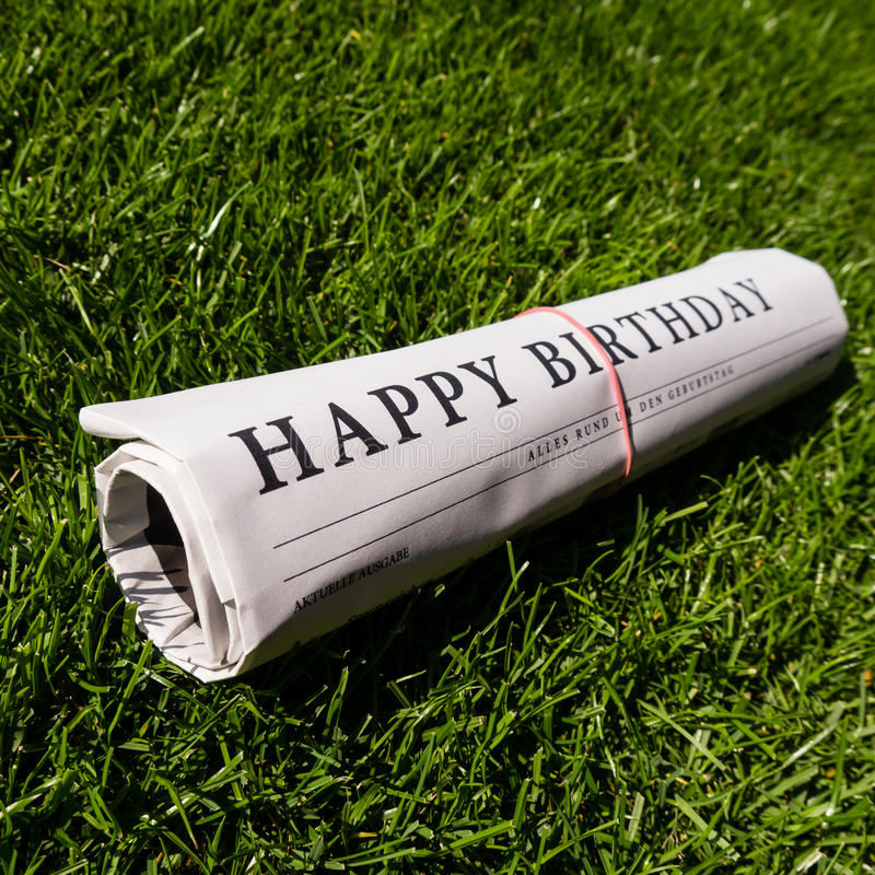 Happy birthday paper. On green grass royalty free stock images