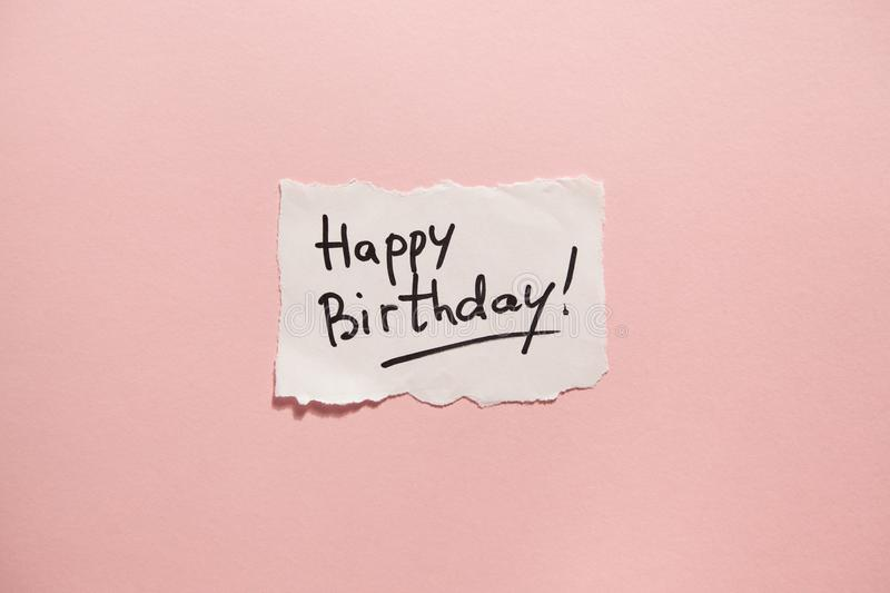 Happy birthday, paper with text on pink background stock image