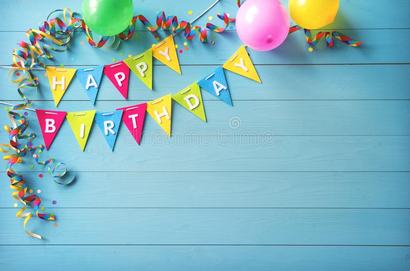 Happy birthday party background with text and colorful tools royalty free stock photo