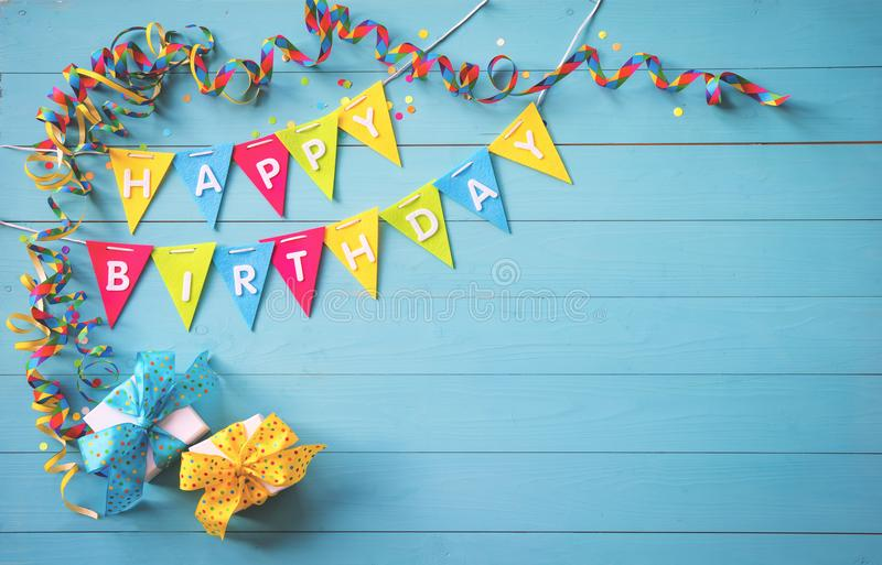 Happy birthday party background with text and colorful tools stock photography