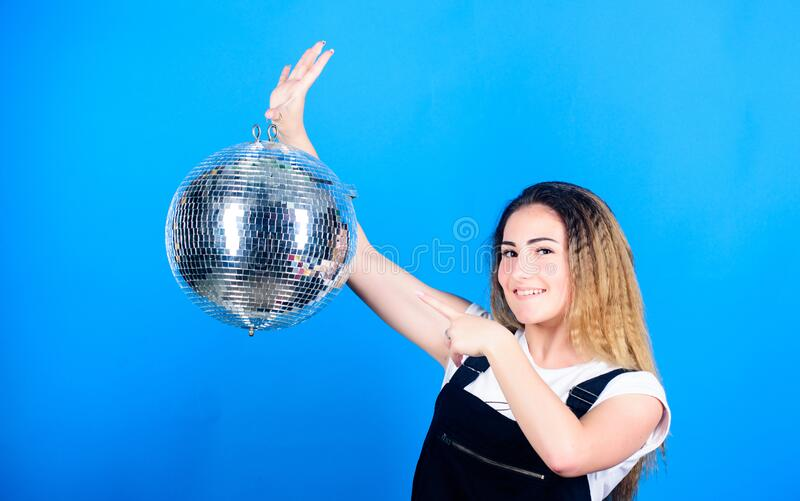 Happy birthday party. disco dancing. celebrating the holiday. girl with disco ball. christmas holiday. event manager stock photography