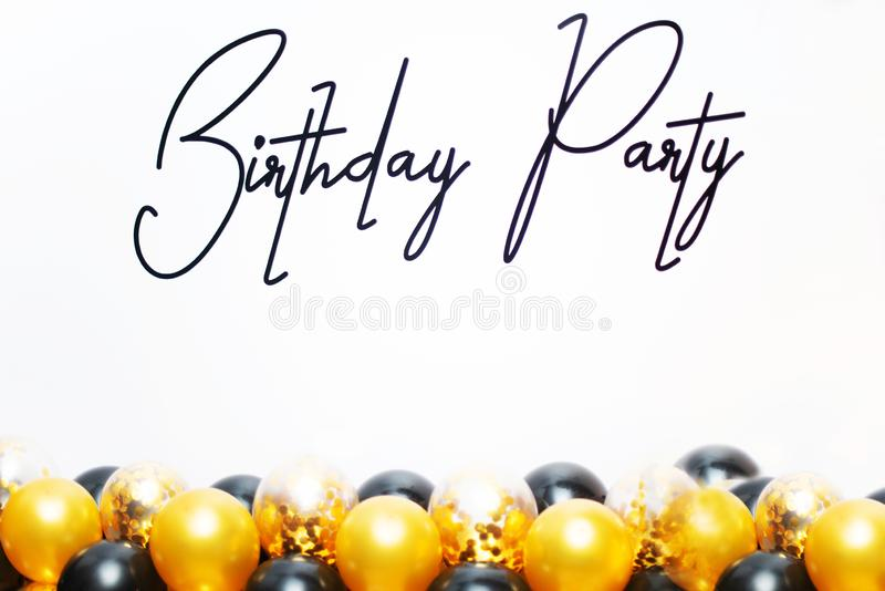 Happy birthday! Birthday party with yellow and black balloons royalty free stock photos