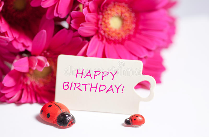 Happy birthday. Pink flowers and card with lettering happy birthday stock image