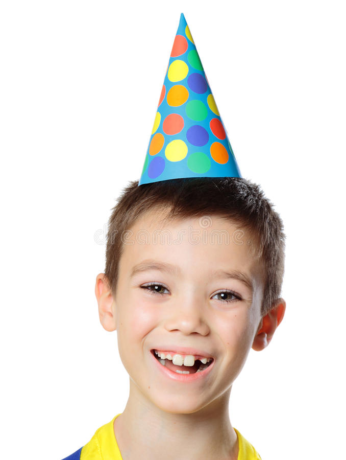 Happy birthday. Portrait of eight years boy with birthday cap on white background royalty free stock photo