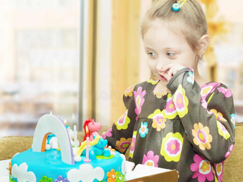 Happy birthday. Portrait of young caucasian child girl at own happy birthday with cake stock photography