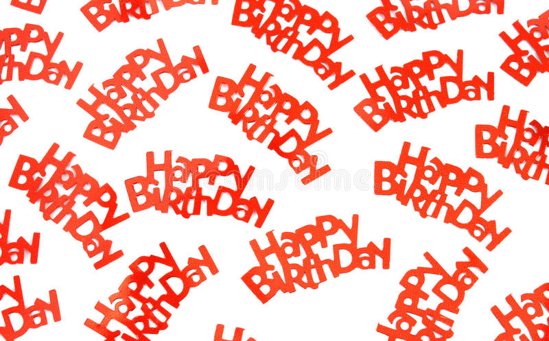 Happy birthday sayings on white background. A group of red happy birthday confetti pieces on a white background stock image