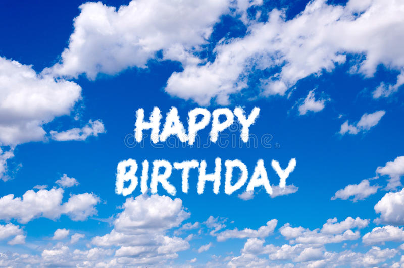 Happy birthday. Sign clouds on the clear blue sky stock photography