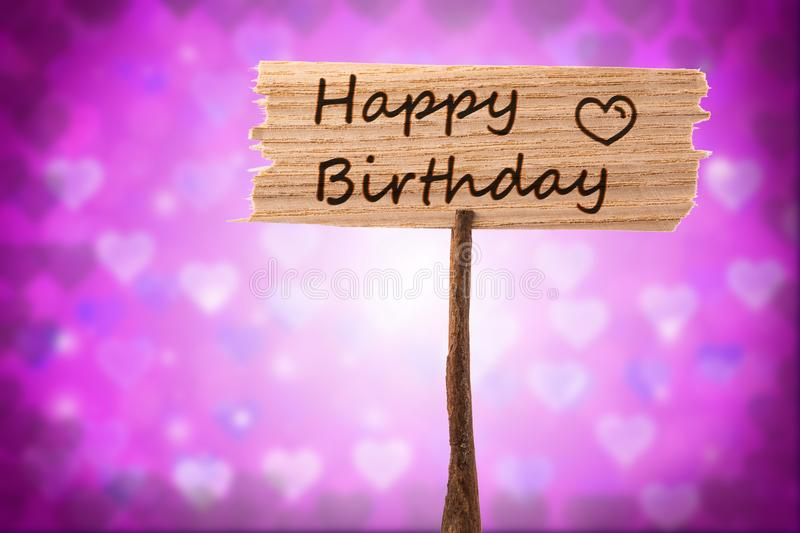 Happy birthday sign. Happy birthday on wood sign , heart shape background royalty free stock image