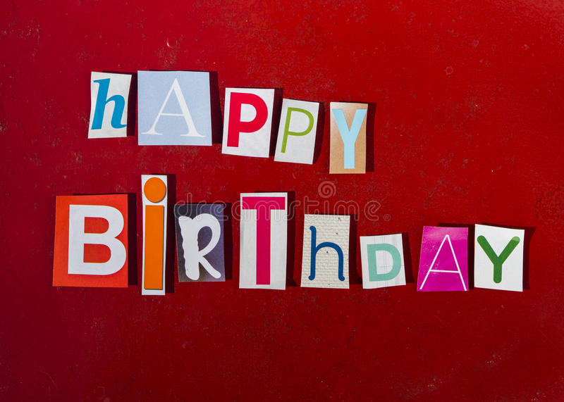 Happy Birthday spelled with magazine letters stock image