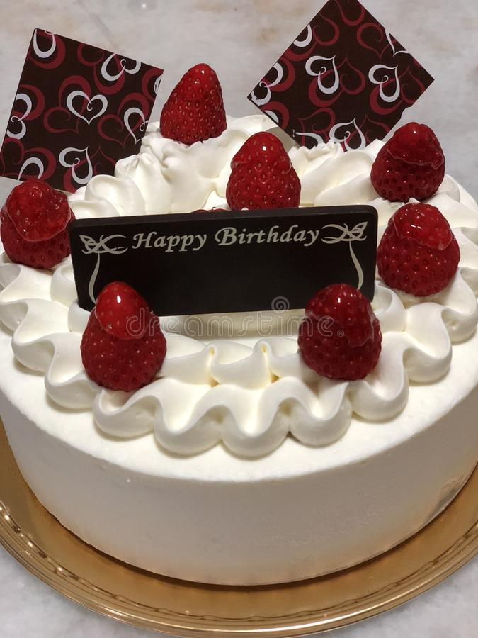 Happy Birthday. A strawberry birthday cake decorated with royalty free stock images