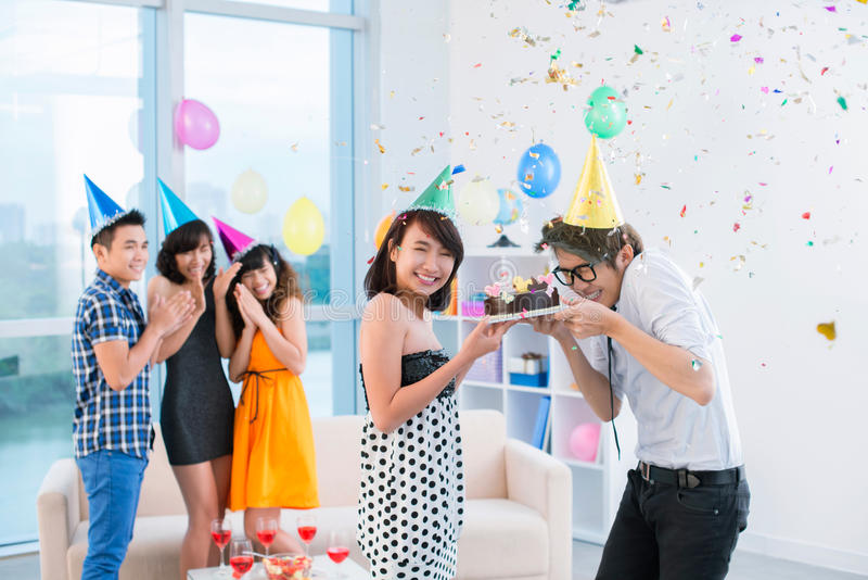 Happy birthday to friends!. Teenagers congratulating their two friends with birthday royalty free stock photo