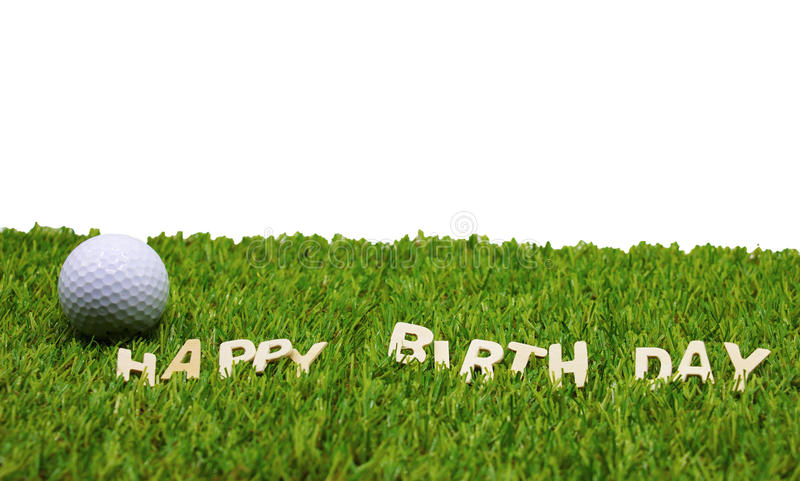 Happy birthday to golfer. Golf ball with happy birthday sign on green grass stock photo