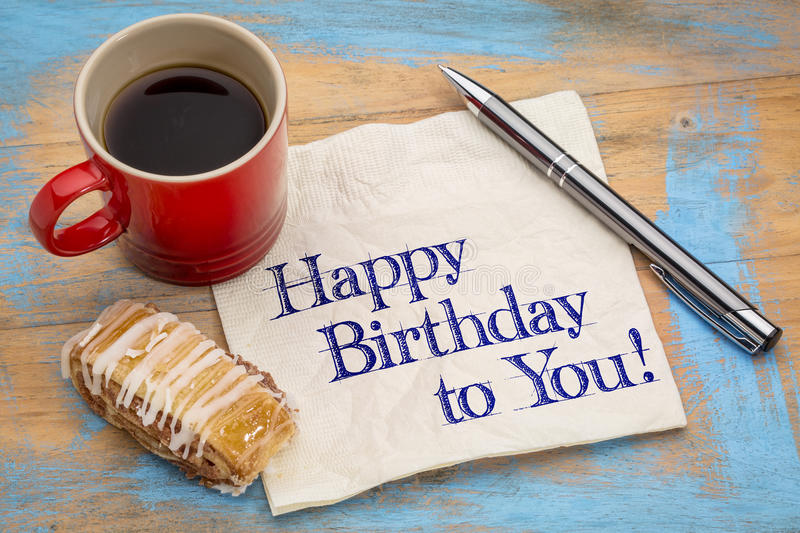 Happy Birthday to you!. Happy Birthday to you greeting - handwriting on a napkin with a cup of coffee and cookie stock photo