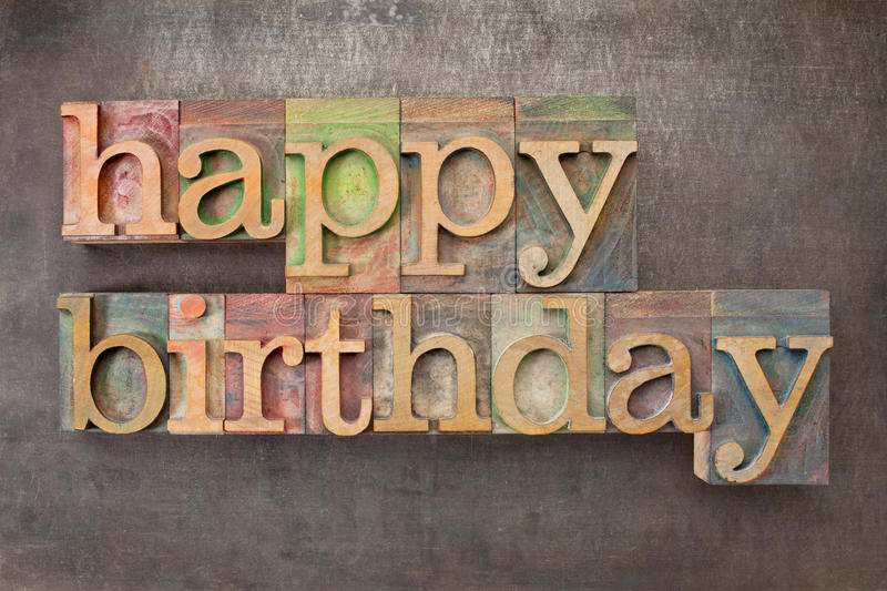 Happy birthday in wood type stock photo