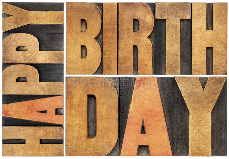 Happy birthday in wood type. Happy birthday - isolated text abstract - letterpress wood type printing blocks scaled to a rectangle stock images