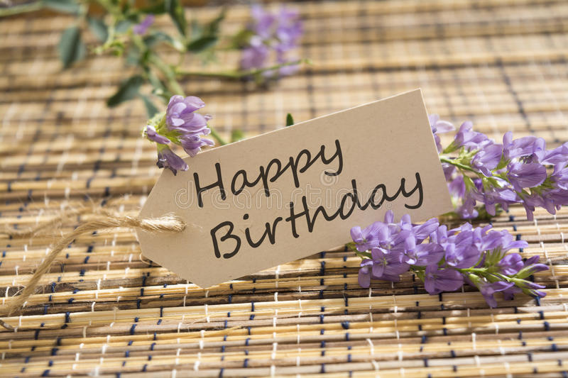 Happy Birthday. Word written on a Looking card on mat stock images