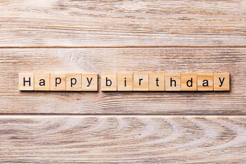 Happy Birthday word written on wood block. Happy Birthday text on wooden table for your desing, concept royalty free stock image