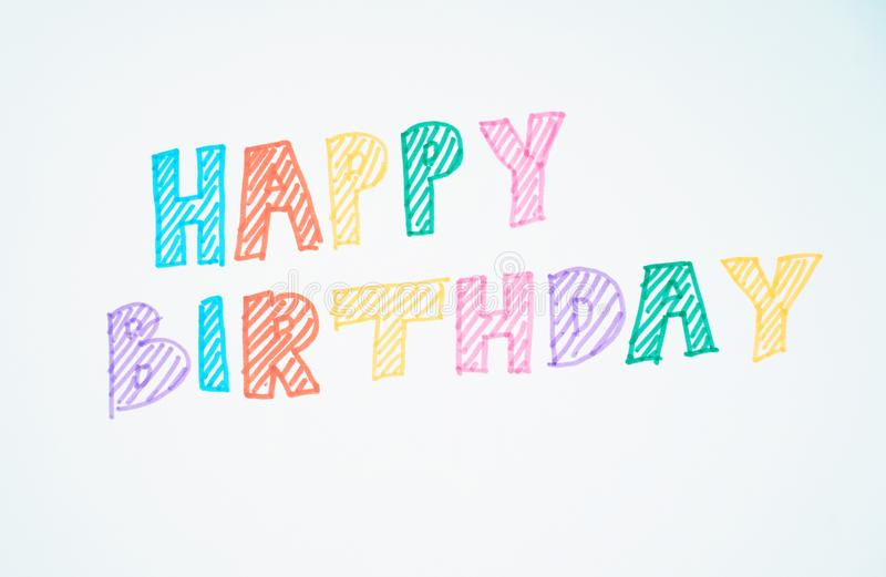 Happy birthday word. Wrote on white paper royalty free stock photo