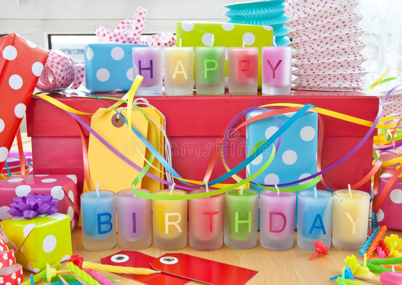 Happy Birthday written on candles. Happy birthday written on colorful candles and little gift boxes stock images