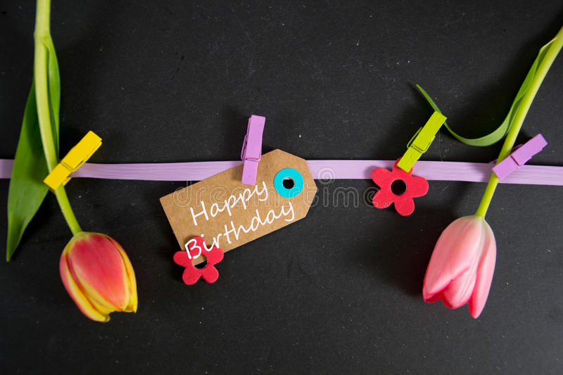 Happy Birthday. Written on a paper tag royalty free stock image