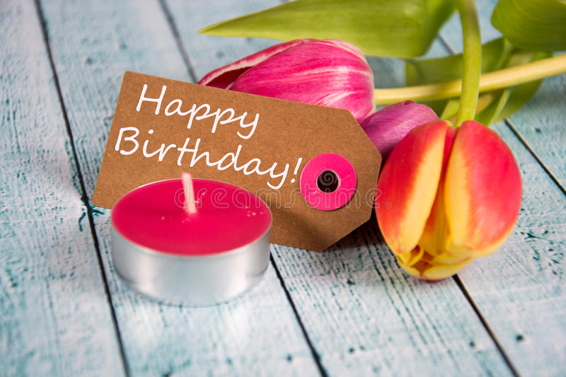 Happy Birthday. Written on a paper tag stock image