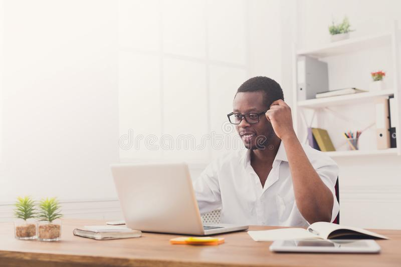 Happy black happy businessman in office, work with laptop, weari. Happy black businessman in office, wearing glasses, work with laptop with pleasure stock images