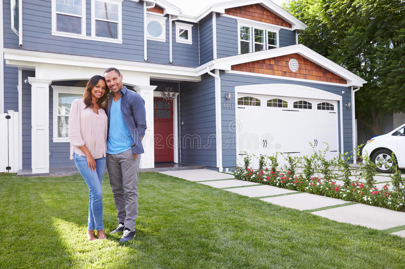 Happy black couple standing outside their house royalty free stock photo