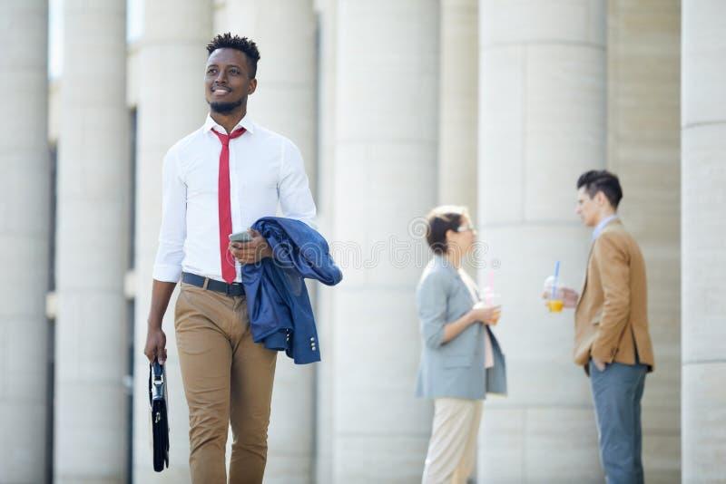 Happy black man going to work royalty free stock photo