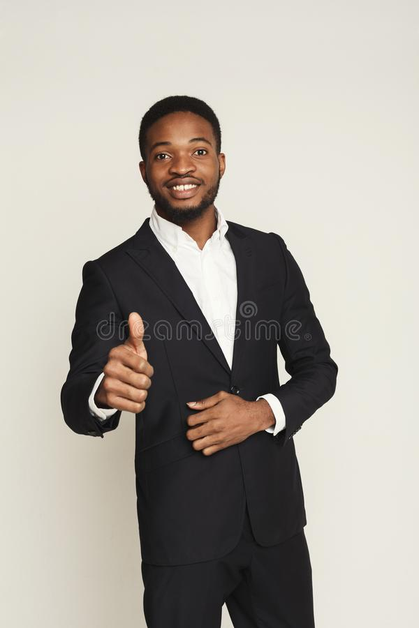 Happy black man showing thumb up gesture, studio shot royalty free stock photo