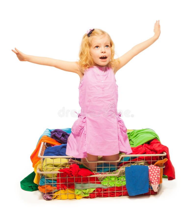 Happy blond girl with a lot of clothes royalty free stock photography