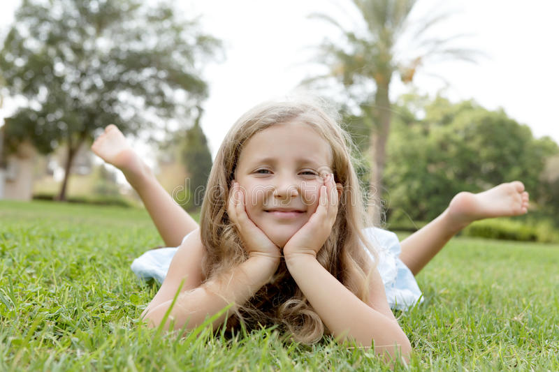 Happy blond girl on nature stock photo