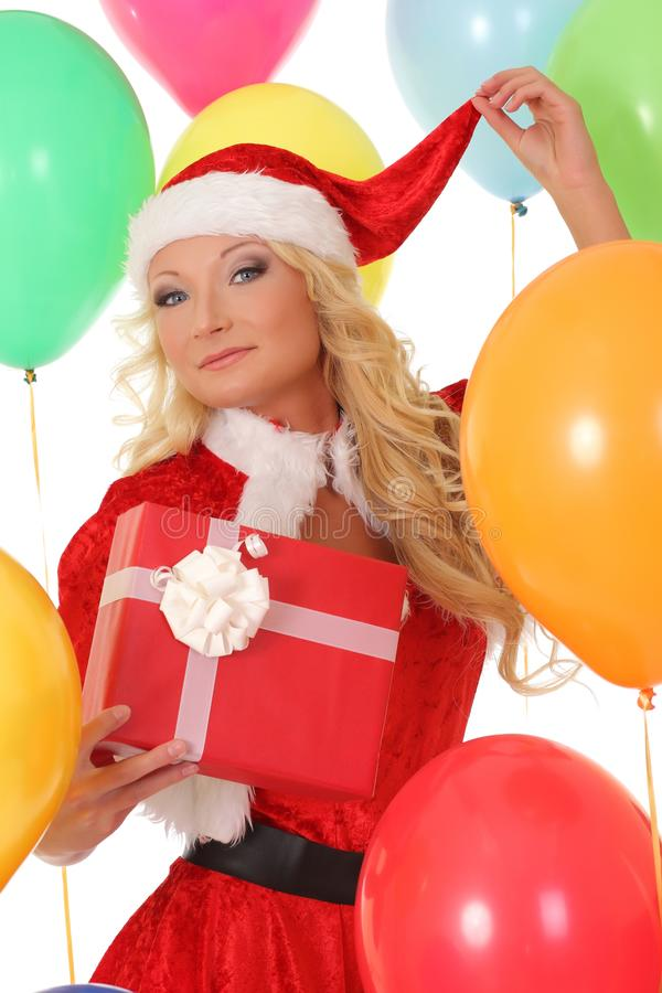 Happy girl in red Santa hat holding gift box royalty free stock photography
