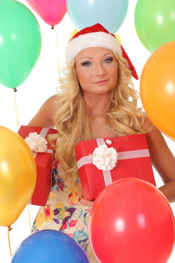 Happy girl in red Santa hat holding gift box royalty free stock image